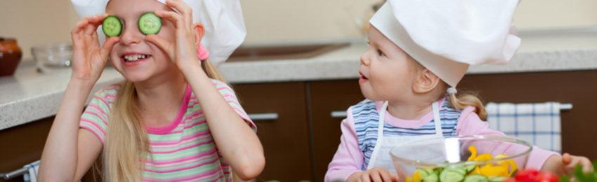 two little girls preparing healthy food on kitchen